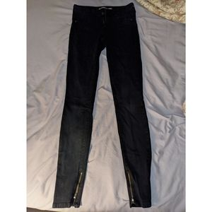 Black Vince jeans with zippers on legs